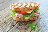 foto of deli  - Grilled deli sandwich with ham and cheese - JPG