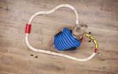 picture of train track  - Top view of little boy playing with his toy train on the track - JPG