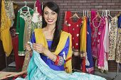 stock photo of dupatta  - Portrait of an Indian female dressmaker working at design studio - JPG