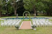 stock photo of lawn chair  - Wedding decor chairs landscape with table settings on porch - JPG