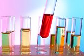 image of tubes  - Test tube filled with red liquid on background of other tubes - JPG
