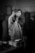 picture of 1950s style  - Brave detective pointing a gun and young scared woman hiding behind him 1950s film noir style - JPG