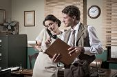 foto of 1950s style  - Young secretary on the phone and director working together 1950s vintage style office - JPG