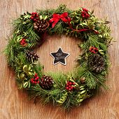 picture of christmas wreath  - the sentence merry christmas written in a star - JPG