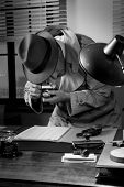 stock photo of 1950s style  - Spy agent stealing top secret data and taking pictures 1950s style office - JPG