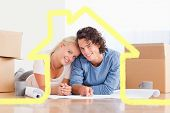 stock photo of home addition  - Couple organizing their future home against house outline - JPG