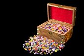 picture of treasure chest  - Treasure chest overflowing with colorful precious gems on black background - JPG