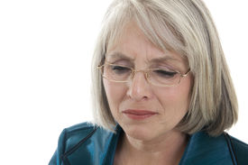 stock photo of matron  - Mature attractive Caucasian woman grieving isolated on white - JPG