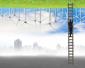 stock photo of inverted  - businessman climb on ladder between two inverted world with pollution cityscape and clean natural sky grass wind turbines environmental protection and alternative energy concept - JPG
