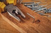 foto of pliers  - pliers  hammer and nail on a wooden board - JPG