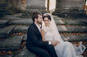 stock photo of yellow castle  - beautiful stylish elegant charming loving couple in the castle - JPG