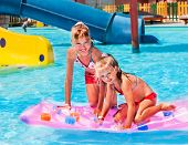 picture of mattress  - Child on water slide at aquapark - JPG