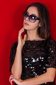 picture of little black dress  - Beautiful brunette girl in a black dress and glasses - JPG