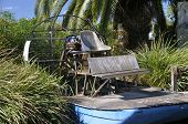 stock photo of airboat  - An old antiquated airboat sets in the tall sawgrass near the Everglades - JPG
