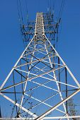 stock photo of voltage  - high voltage electric power lines on pylons - JPG