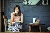 stock photo of cafe  - Asia women drinking coffee in cafe shop on free day - JPG