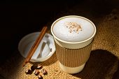 stock photo of coffee crop  - Paper cup of coffee and coffee beans on wooden table - JPG