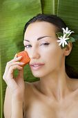stock photo of facial  - Beautiful caucasian woman having fresh papaya natural facial mask apply skin care and wellness - JPG