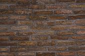 picture of brick block  - Background pattern of weathered old brick wall texture grungy rusty brushed blocks as urban architecture backdrop - JPG