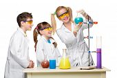 foto of chemistry  - Teens and teacher of chemistry at chemistry lesson making experiments isolated on white background - JPG
