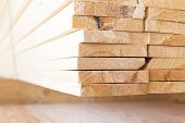 pic of lumber  - stack of lumber in timber logs storage for construction or industrial work  - JPG