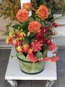 picture of tub  - Wooden display tub of pastel coloured roses and other flowes - JPG