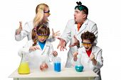 stock photo of chemistry  - Teens and teachers of chemistry at chemistry lesson making experiments isolated on white background - JPG