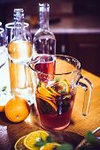 foto of sangria  - Large jar of sangria with red wine, oranges and ice for home party, home kitchen interior. Homemade food and drinks