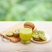 picture of juices  - Fresh juices and fruits on white wooden background - JPG