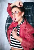 Постер, плакат: Punk Girl Doing A Bubble With A Chewing Gum