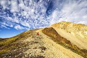 stock photo of denali national park  - Denali Hiker approaching an unnamed summit - JPG