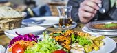 foto of lamb  - lamb with vegetables and dessert tea in a Turkish restaurant - JPG