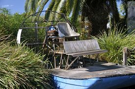 picture of airboat  - An old antiquated airboat sets in the tall sawgrass near the Everglades - JPG