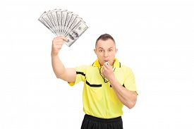picture of referee  - Furious football referee blowing a whistle - JPG