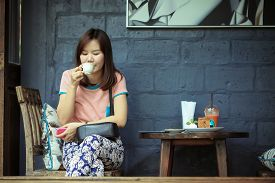 picture of cafe  - Asia women drinking coffee in cafe shop on free day - JPG