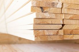 stock photo of lumber  - stack of lumber in timber logs storage for construction or industrial work  - JPG