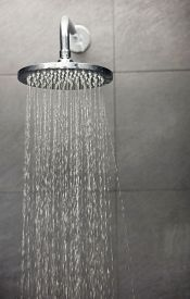 foto of douche  - Shower head with water stream - JPG