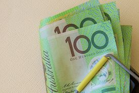 image of mouse trap  - Australian one hundred dollar notes trapped in a mouse trap - JPG