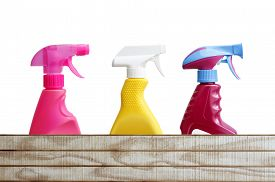 stock photo of trigger sprayer bottle  - Three cleaning bottles above wood  - JPG
