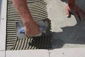 stock photo of grout  - On this picture is hands - JPG