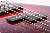 Metallic Volume Treble Guitar Bass Knobs. Electric Guitar. Red Electric Bass Guitar Close-up. Musica poster