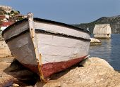 stock photo of old boat  - a boat and an ancient tomb in the sea at kekova turkey - JPG