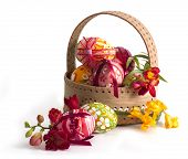 stock photo of easter flowers  -  Basket full of Easter eggs and flower - JPG