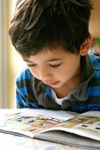 Closeup Of Boy Reading His Book