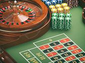 Gambling or casino background concept. Casino roulette wheel with casino chips on green table. 3d il poster