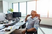 Business Investor In A Happy Mood Talking Over Phone In Office. poster