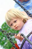 Toddler Girl On Outdoor Swing poster
