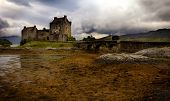 Mystic Eilean Donan Castle with lake Scotland