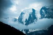 Low Cloud Before Huge Glacier. Giant Snowy Rocky Mountains Under Cloudy Sky. Thick Fog In Mountains  poster