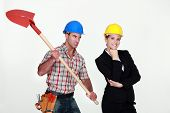 stock photo of unawares  - Construction worker preparing to hit an engineer over the head - JPG